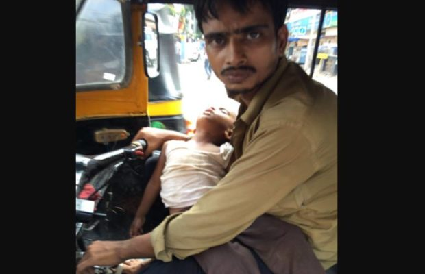 help-for-mumbai-auto-driver-with-paralysed-wife-after-photo-of-him-carrying-2-year-old-son-goes-viral