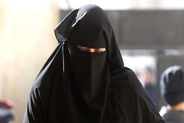 A man caught wearing a burqa at Aligarh railway station